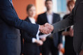 Business partners partnership concept with two businessman handshake Stock Images