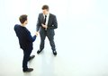 Business partners shaking hands as a symbol of unity view from the top Stock Photography