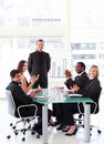 Business people applauding a colleague in a presen Stock Photography