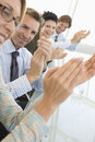 Business people applauding in conference room happy businessman with colleagues Royalty Free Stock Photo