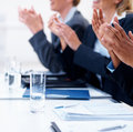 Business people applauding at a seminar by glass Royalty Free Stock Photos
