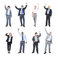 Business people celebrating with their hands raised group of Stock Photo