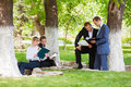 Business people in a city park Royalty Free Stock Photo