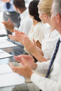 Business people clapping colleague at a meeting in the office Stock Photo
