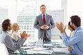 Business people clapping hands in board room meeting young at office Royalty Free Stock Photo