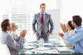 Business people clapping hands in board room meeting young at office Royalty Free Stock Image