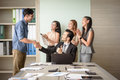 Business people clapping in office after signing agreement Royalty Free Stock Photo