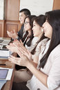 Business people clapping their hands Royalty Free Stock Image