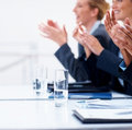 Business people clapping their hands at a meeting Stock Images