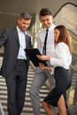 Business people discussing documents and ideas business team Stock Images