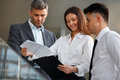 Business people discussing documents and ideas business team Stock Image