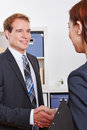 Business people doing job interview two smiling in office after a handshake Stock Photography