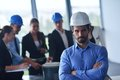 Business people and engineers on meeting group presentation in bright modern office with construction engineer architect worker Stock Photos