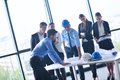 Business people and engineers on meeting group presentation in bright modern office with construction engineer architect worker Stock Images
