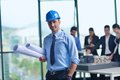 Business people and engineers on meeting group presentation in bright modern office with construction engineer architect worker Stock Photography