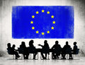 Business people with european union flag discussing around the conference table and a of above Stock Images