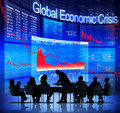 Business people facing global economic crisis Stock Photo