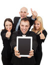 Business people giving a thumbs up group of smiling tp and holding tablet pc Stock Photos