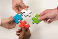 Business people group assembling jigsaw puzzle and represent team support Royalty Free Stock Photo