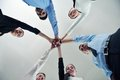Business people group joining hands and representing concept of friendship and teamwork low angle view Royalty Free Stock Photos