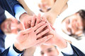 Business people group joining hands and representing concept of friendship and teamwork low angle view Stock Photo