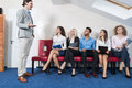 Business People Group Meeting Sitting In Line Queue, Businesspeople Recruitment Waiting for Job Interview Candidate Royalty Free Stock Photo
