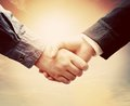 Business people handshake. Sunny vintage sky Royalty Free Stock Photo