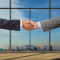 Business people handshaking on background of modern office Stock Photo