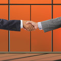 Business people handshaking on background of modern office Stock Photos