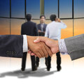 Business people handshaking on background of modern office Royalty Free Stock Image