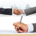 Business people handshaking with document signing Stock Photos