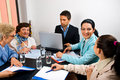 Business people having conversation at meeting Royalty Free Stock Photo