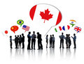 Business people having a discussion with each other silhouettes of and speech bubbles different national flags above them Stock Image