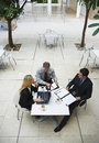 Business people having a discussion at office cafe high angle view of businessmen and businesswoman Royalty Free Stock Photo