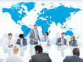 Business People Having a Discussion and World Map Royalty Free Stock Photo