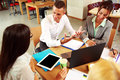 Business people having meeting around table Royalty Free Stock Photo