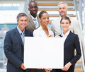 Business people holding a blank board Stock Image
