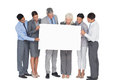 Business people holding blank board in office Royalty Free Stock Photography