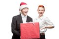 Business people holding christmas gift Stock Images