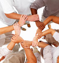 Business people holding each others hands Royalty Free Stock Photos