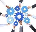 Business people holding gears together Stock Photos