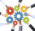 Business people holding gears together isolated on white background Royalty Free Stock Photos