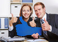 Business people holding many thumbs two happy up in the office Stock Photos