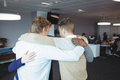 Business people huddling together Royalty Free Stock Photo