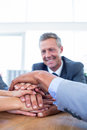 Business people joining hands together in the office Stock Photography
