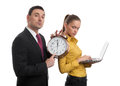 Business people with laptop and alarm clock two Royalty Free Stock Photography