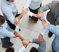 Business people linking hands in teamwork Stock Photography