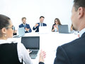 Business people listening to presentation at seminar Royalty Free Stock Photo