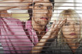 Business people looking through blinds young Royalty Free Stock Images