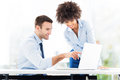 Business people looking at laptop smiling Royalty Free Stock Photo